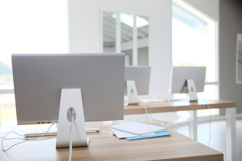 Desktop computers set on tables in classroom.jpeg