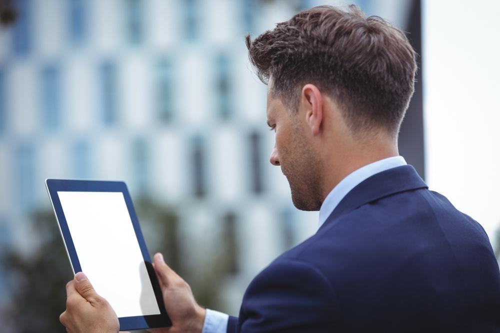 Close-up of businessman using digital tablet-1.jpeg>                                 </a>                                 <div class=