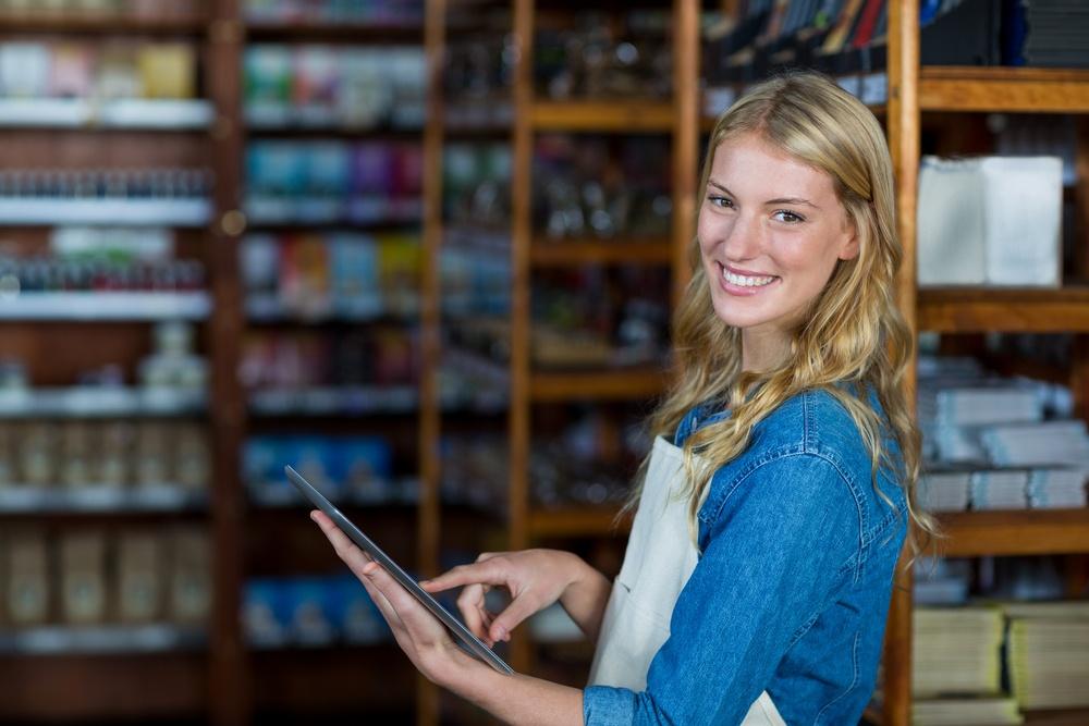 Portrait of smiling female staff using digital tablet in super market.jpeg>                                 </a>                                 <div class=